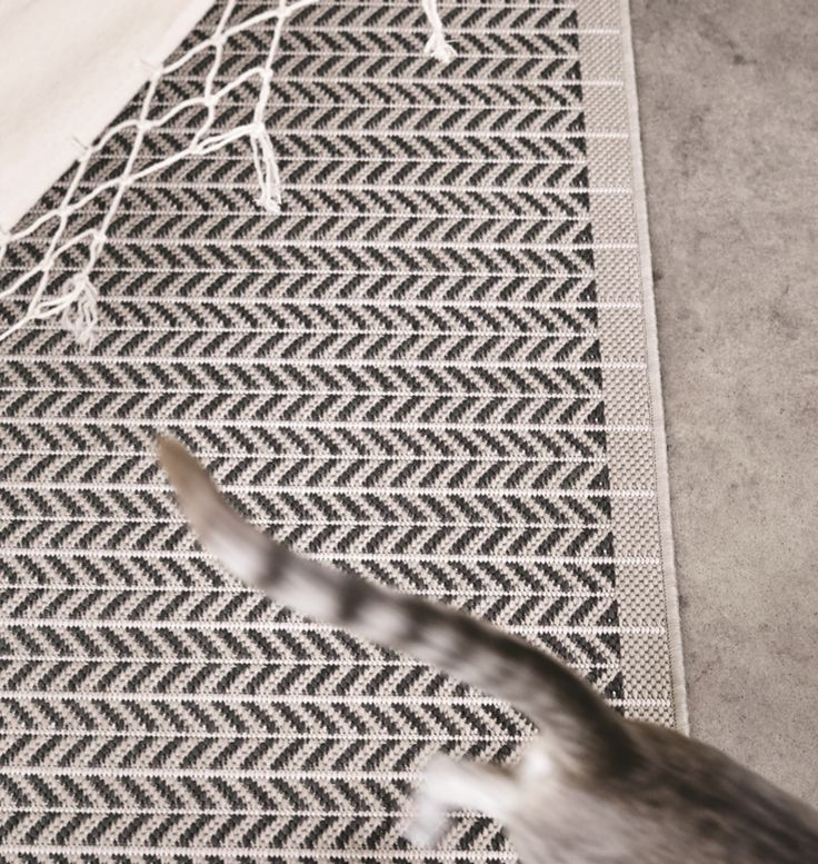 How To Keep Rugs From Slipping On Carpet