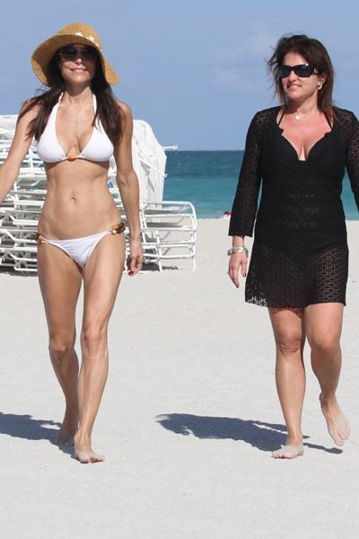 Bethenny Frankel shows off her fab figure in a white bikini and large straw hat in Miami Beach. Frankel, who invited the Skinny Girl line of drinks and products, was in town for the Food Network South Beach Wine and Food Festival.