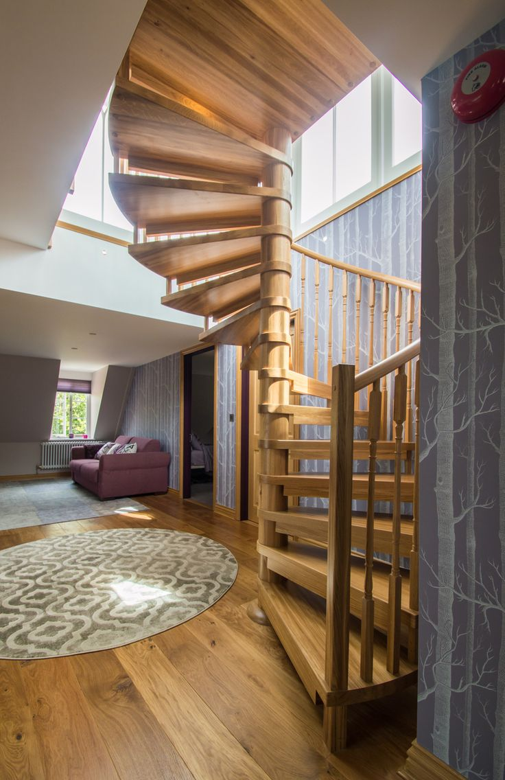 A timber spiral staircase situated in a loft space