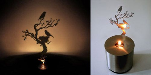 miniature lamp that create tree and bird shadows on a wall