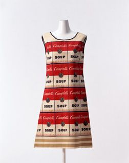 "4. Dress ""The Souper Dress""c. 1966-America Designer:  Anonymous Brand:  Unknown Label:  none Material:  ""Campbell's Soup"" can-motif printed non-woven mini dress with black bias tape. This ""paper dress"" repr"