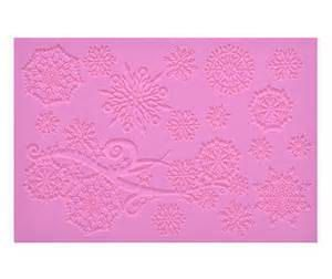 Crystal is a silicone Cake Lace Mat by Claire Bowman that produces various snowflakes designs linked together by swirling branches. This will make