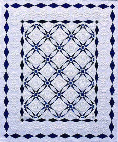 Space for lovely quilting in the wide white borders. Blue diamonds add a nice touch.