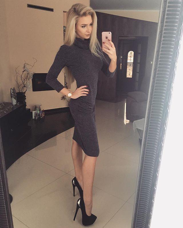 Beautiful slim bodied blonde Justyna Antkowiak showing her gorgeous look in stylish long sleeved polo-neck dress with high heels. #blondegirl #polskadziewczyna #polishgirl