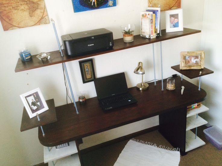 Home Office desk with shelves attached with steal rods and display shelves