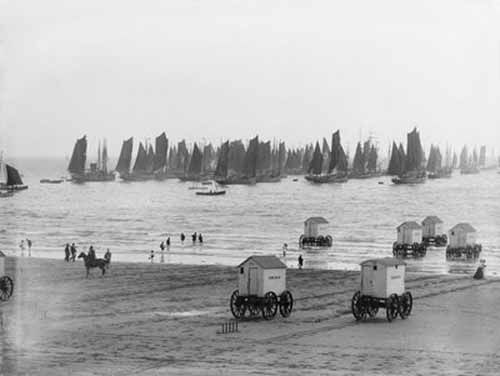 Scarborough beach, England, taken in 1897. The bathing trolleys (also called bathing machines) were made so that victorian ladies could get undressed and into their (less than revealing) bathing suits, then be pushed, or pulled, into the sea, and get into the water without revealing themselves to the men's gaze.