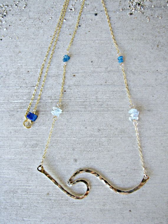 The perfect gift for a March birthday or for the ocean-lover. Also available in any other color combination or birthstone. Just send me a message! :0)  This is my popular Tiny Wave Necklace, but with a little gemstone upgrade! :0) Petite pieces of Aquamarine and Apatite gemstones dot the delicate chain attached to the hand-formed and hand-hammered Tiny Wave Pendant. I added a little Lapis Lazuli gemstone at the clasp/closure.  At checkout, you may choose between Sterling Silver ($75-Show...