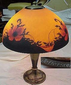 Beautiful Jefferson poppy reverse painted table lamp, Painted in an exquisite array of upturned and forward facing poppies~gorgeous shades of orange ~ red and yellow~Above a darkened shadow of leafy vines and ground