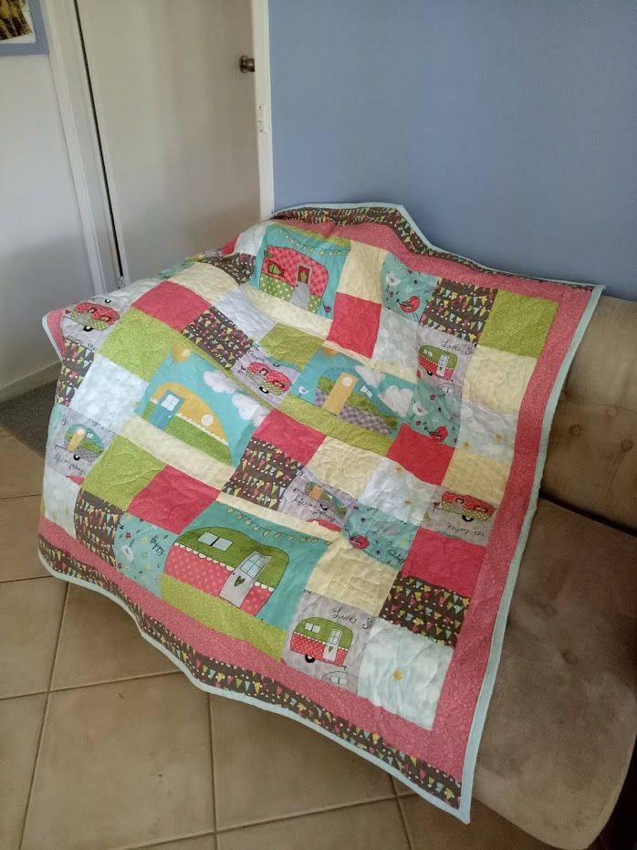 Snuggle quilt for daughter 1's caravan, made from placemat material