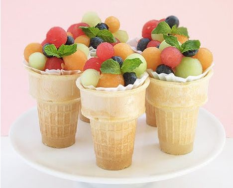 """Lovely and healthy!!!  As simple as it looks - melon ball & blueberry salad, mint garnish, nestled in cupcake cup inside ice cream cone.  """"P.S.  all the mamas at the birthday party will love you for this!"""""""