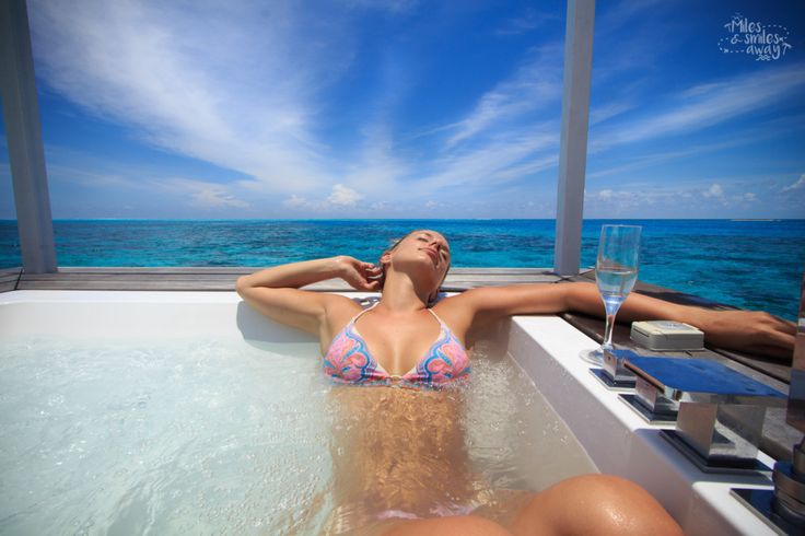 Luxurious jacuzzi at Diamonds Thufushi resort in Maldives. .With glass of good wine!