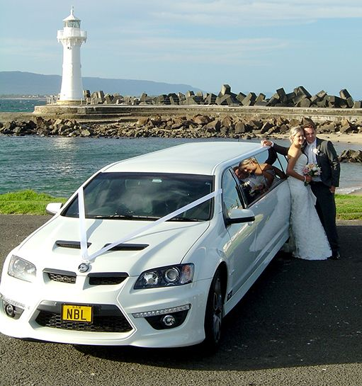 Bride & Groom with the HSV wedding car