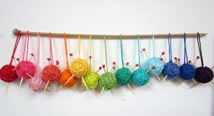 Mini Yarn Balls | Planet Penny Blog. LOVE! Mini yarn balls hanging on a knitting needle? Yes Please!