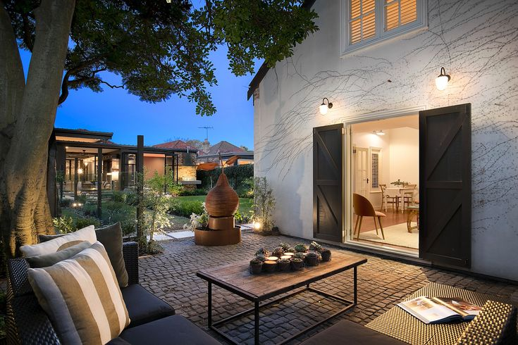 Landscaped gardens, two distinct courtyards, level lawns