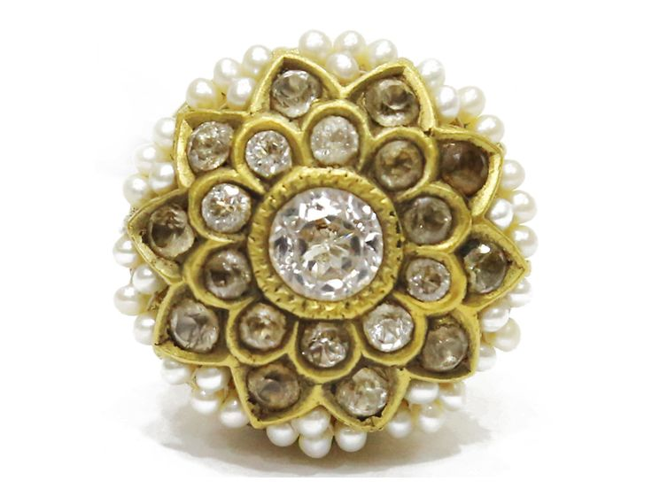 Old Rajasthani Borla in gold studded with uncut diamonds and pearls, from Karni Jewellers.