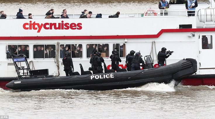 Terror drill: Hundreds of armed police in boats zoomed down the river Thames today as part of major anti-terrorist drill in London