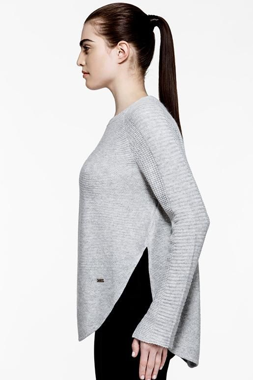 Designed with comfort in mind, this essential sweater is made with an intended relaxed fit and ultra soft fabric blend to keep you feeling warm and cozy.  A rounded hemline features side slits for freedom of movement and makes this the perfect style to layer up with leggings.    Stylist's Notes: Try wearing this sweater with our Lucky High Rise Leggings for an effortless look.