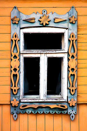 Charming wooden windows in the village near Suzdal.