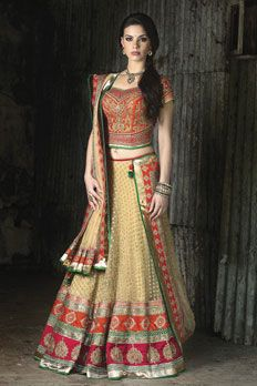 Net ghagra with raw silk blouse, with all over diamond work and zardosi work along with net dupatta.