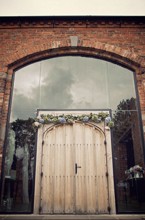 flower arch outside shustoke farm barns. See more of our floral designs at www.passionforflowers.net. Voted Best Wedding Florist in ENGLAND in The Wedding Industry Awards.