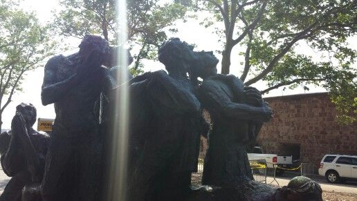 A ray of hope. Statue commemorating the struggles of the early 20th century immigrants