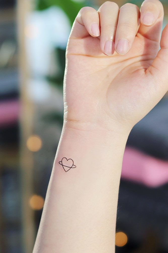 33 Delicate Wrist Tattoos For Your Upcoming Ink Session Meaningful Wrist Tattoos Cool Small Tattoos Small Heart Tattoos