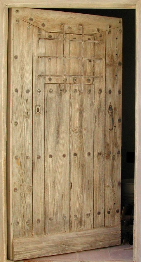 rustic doors | Rustic entrance door with bars Aged wood finish. Front doors . Portes ...