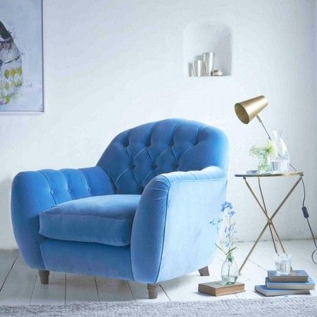 Blue armchair and white wood floors, a modern living room look from Loaf at www.redonline.co.uk
