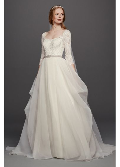 Love this three quarter sleeve ball gown wedding dress!! Bridal gown by #DavidsBridal