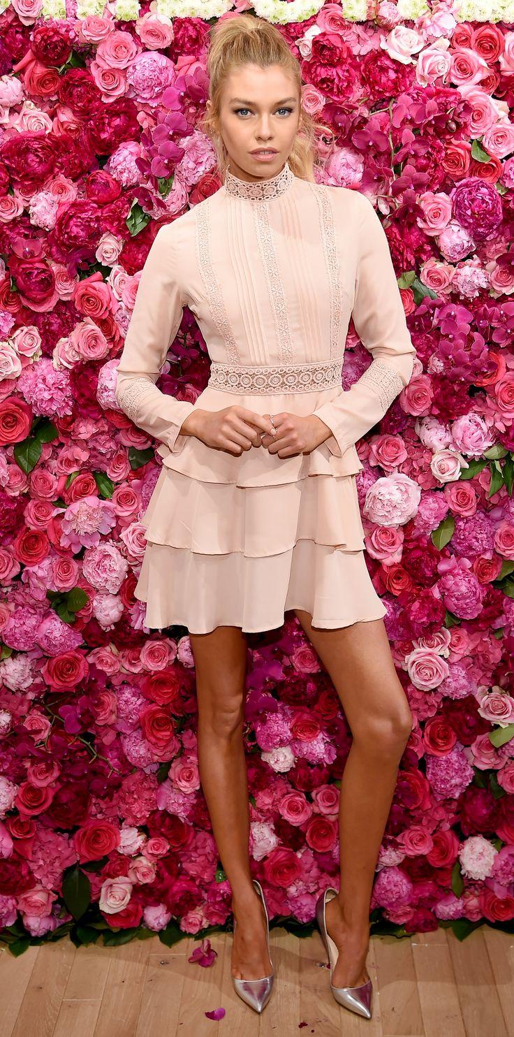 Stella Maxwell in a tiered ruffle dress.