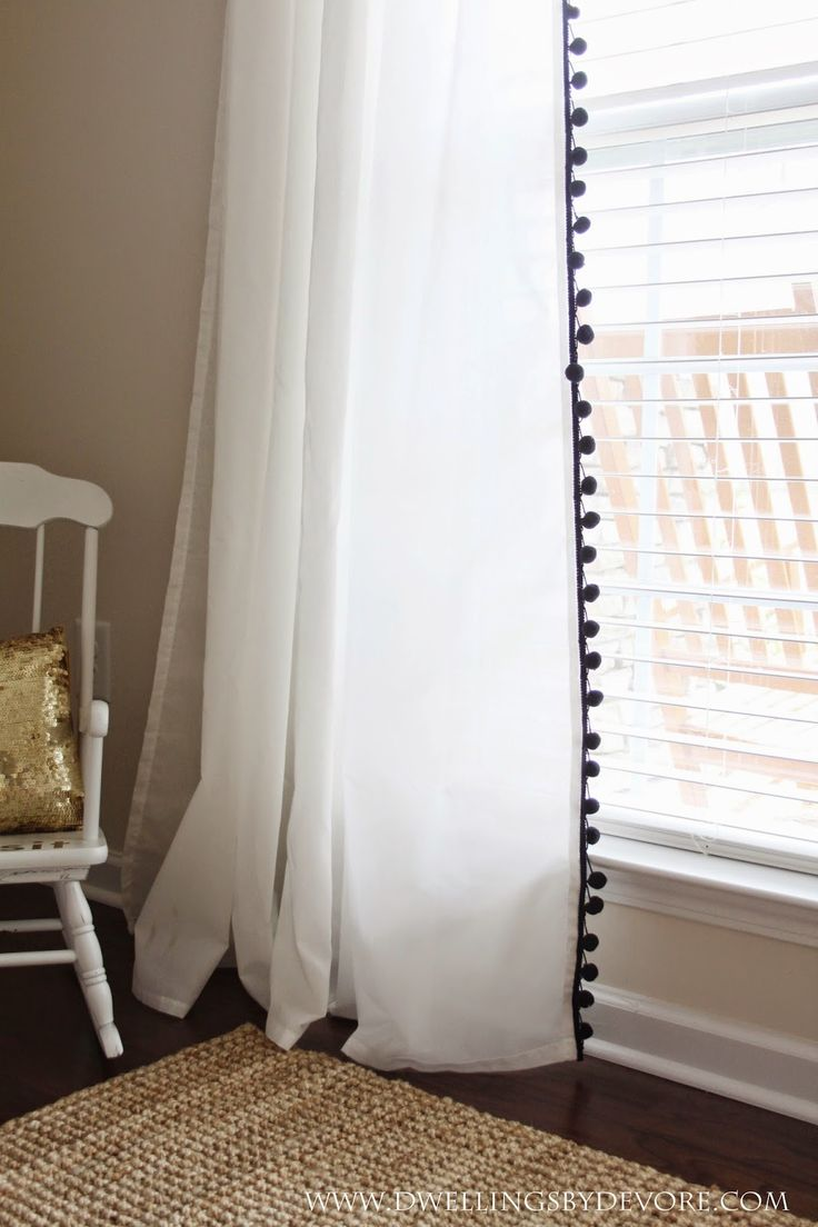 Add pom pom trim to inexpensive IKEA curtains ($9.99/pair) for cute curtains on a budget