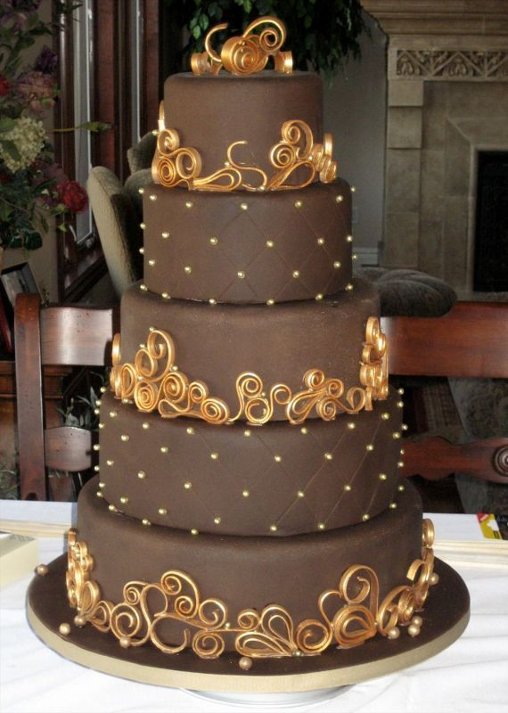 chocolate frosted wedding cake with golden accents