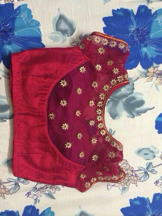 Red and gold statement saree blouse design.