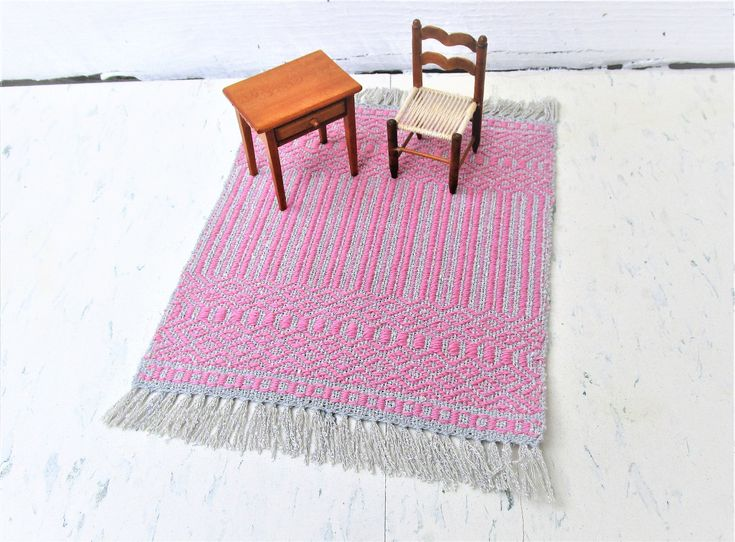 Silver and Pretty Pink Hand Woven Miniature Dollhouse Rug. Rose Path threading. Wool weft, silk warp table rug. 7″ by 10″ including fringe