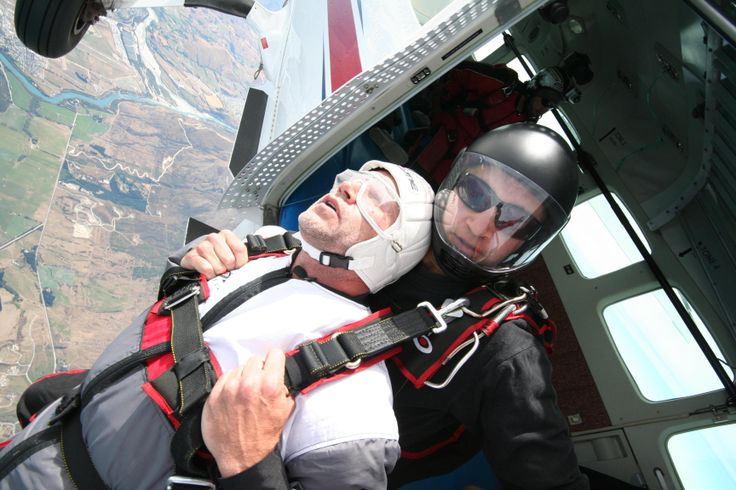 New Zealand rugby star Marc Ellis on the edge of a plane over Queenstown - no turning back!
