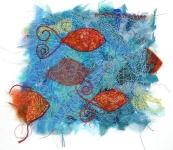 Like a fish in the ocean'. 'Threads' van Molomimi. Handgemaakte kunststukjes van gerecycled textiel. Fairtrade uit Zuid Afrika.