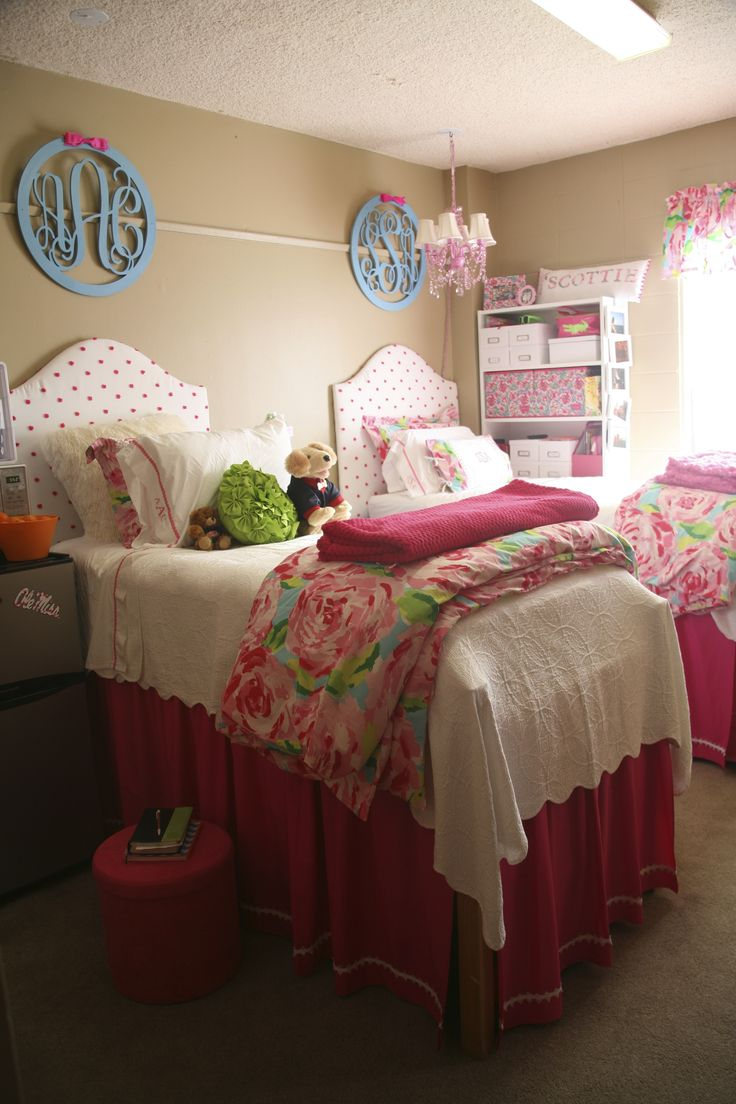 Here is my daughter's & roommate's room in Crosby Hall at Ole Miss. They started with some ideas found from a former pin on Pinterest and added their own ideas. The bedskirts, headboards & chair covers were made by the roommate's mom! The Lilly Pulitzer comforter cover and pillows comes from Garnet Hill. I created the lamp shade and curtain topper with Lilly fabric found on Etsy. The monogram medallions came from Etsy.