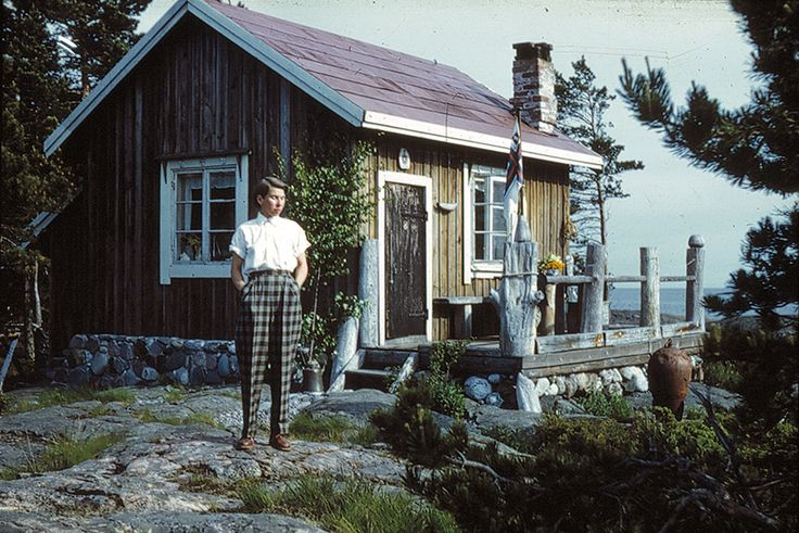 Tove Jansson on the island of Bredskär in 1950. Tove and Lars Jansson bought the island and built a house called Vindrosen (The Wind Rose) in 1947. The whole family moved in except for Tove's brother Per Olov Jansson (who also took this photo), since he already had a cottage on a nearby island. In post-war Finland, building material was hard to come by and among other things, nails were pulled out and straightened from old planks to make the building possible.