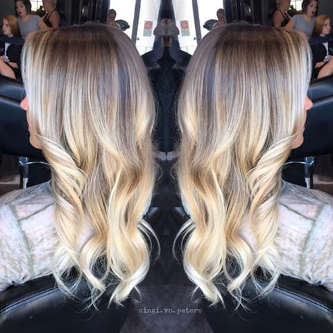 Stretched the roots on this blonde and brightened her tips. No toner, just raw…