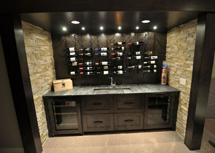 Dark cabinetry and ceiling and floor to ceiling stone give for Custom wine bar