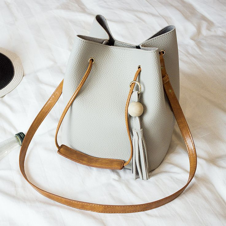 $23.99 (Buy here: https://alitems.com/g/1e8d114494ebda23ff8b16525dc3e8/?i=5&ulp=https%3A%2F%2Fwww.aliexpress.com%2Fitem%2FFree-shipping-new-women-shoulder-bag-new-wooden-bucket-bag-tassel-retro-hand-raisins-mother-bags%2F32735941325.html ) Free shipping!new women shoulder bag new wooden bucket bag tassel,retro hand raisins mother bags,embossed single shoulder bag for just $23.99