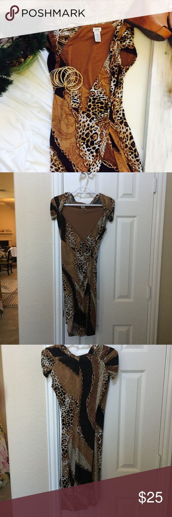 Cache Animal Print Cap Sleeve Dress Worn once, this beautiful dress is perfect for any event. It's made with Spandex and is cinched on the sides. Cap sleeve low cut neck. Falls above the knee. Open to offers Cache Dresses Midi