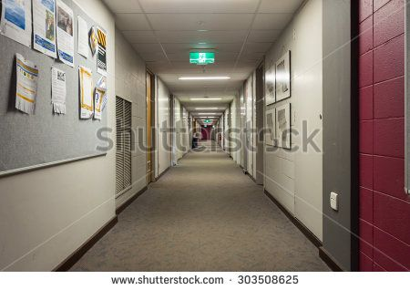 Melbourne, Australia - August 2, 2015: hallway within the Arts Faculty in the Robert Menzies Building on the Clayton campus of Monash University. The Menzies Building has typical 1960s architecture. - stock photo