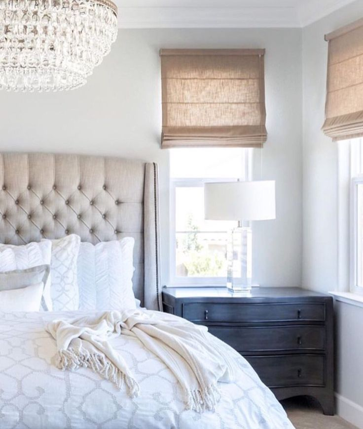 We love the combination of the tufted headboard with a mix of neutral colors and textures in this bedroom.