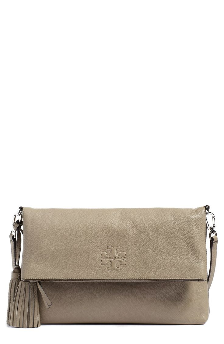 - Richly pebbled leather comprises a fold-over crossbody bag finished with an embossed logo and an optional leather strap. - Top zip closure. - Optional, adjustable crossbody strap. - Interior zip, sn