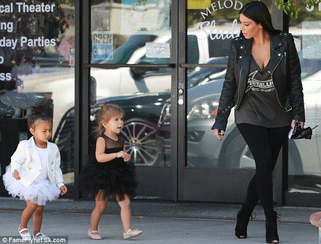 Follow the leader: Penelope, two, was seen in a black leotard and tutu while North wore a white version
