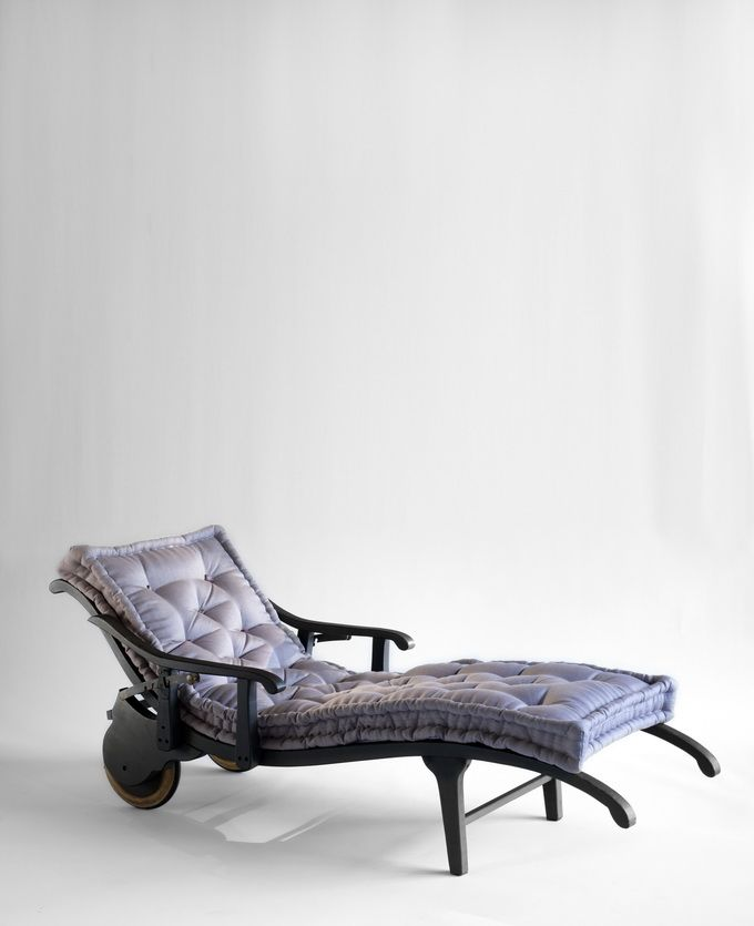 BB for Reschio - The Corsini Recliner - An ebonized beech recliner, the mortise and tenon frame supported by wooden wheels having deeply rebated solid rubber tyres. B.B. - I love the crazy extended wheel barrow effect. The design taken from an original unearthed  in the depths of the Corsini Palace attics. At home on a terrace or in a library. When vertically positioned this piece takes on an almost sculptural quality. www.reschio.com