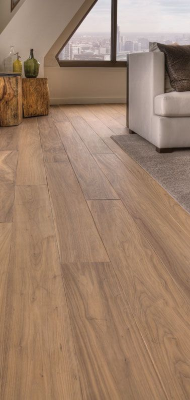 Walnut wide-plank flooring with a natural finish. For ground floor