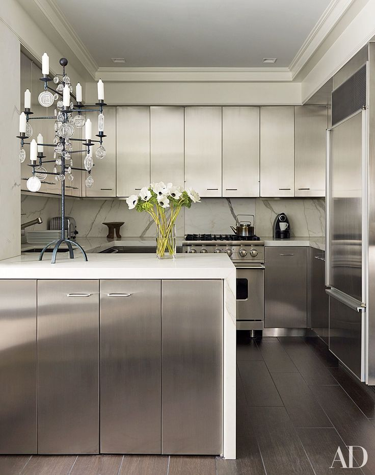 david kleinberg designs a warm and modern manhattan apartment manhattan designers The kitchen of designer David Kleinbergu0027s Manhattan apartment features  stainless-steel cabinets offset by Calacatta gold marble counters.