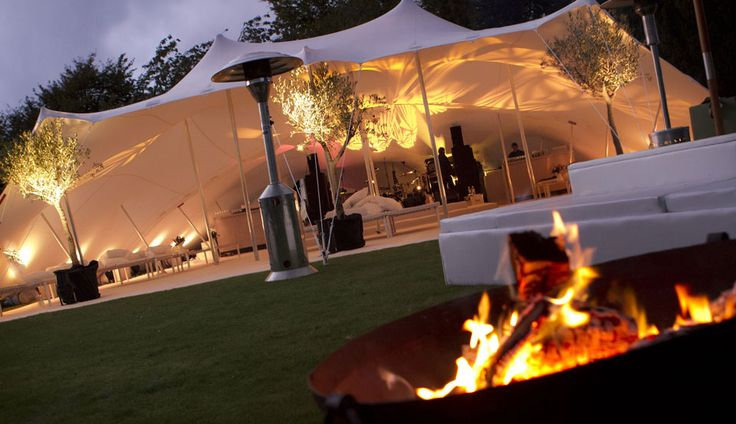 The beautiful curves of our white stretch tents look fantastic when expertly lit.